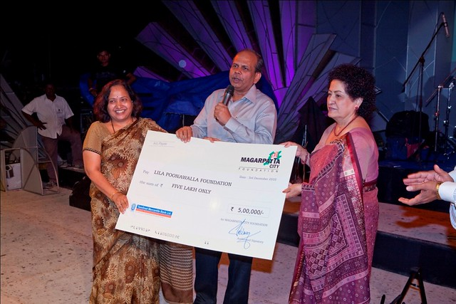 A humble contribution from Magarpatta City Foundation to Lila Poonawalla Foundation - (l to r) Mrs. Rajlaxmi Bhosale, Mr. Satish Magar & Mrs. Lila Poonawalla