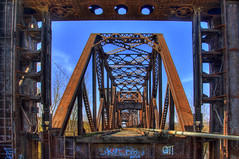 Abandoned Kaw River Railroad Bridge (Thad Roan - Bridgepix) Tags: railroad bridge blue sky abandoned metal river steel historic kansascity missouri frame kansas pipeline hdr kaw truss photomatix 201011 246x7