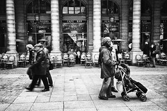~ coming and going ~ (Janey Kay) Tags: winter people blackandwhite bw paris blancoynegro film walking december noiretblanc hiver kay streetphotography nb sw sep analogue janey schwarzweiss personnes argentique ruederivoli 2010 dcembre pousette parisstreetscene streetphotographyparis janeykay niksilverefexpro parisianstreetscene lesruesdeparis fujifilmdiscovery scenedevieparis2010 manpushingpushchair