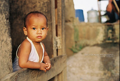 Contemplation does not know age (*Randee) Tags: kids philippines streetphotography fujifilm cavite silang rurallife childrensportraits canon50mmf14usm canoneosrebelg dwcffstreet
