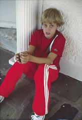 Matt, waiting (Apotheoun) Tags: boy red sitting fluorescent blond porch 1981 column kodachrome stucco flagstone epsonv750 silverfastai