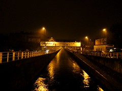 I should be sleeping (Teo 83) Tags: bridge milan water rain river lights milano fiume ponte luci acqua railways riflessi pioggia naviglio ferrovia reflexes pavese sponde sottoilcielodimilano