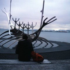 fin de siècle (hurtingbombz) Tags: 120 6x6 girl bench iceland reykjavik bronica mf provia f28 harbourside 80mm sólfar 400x sqai pushedtwostops zenzanon rückenfigur ps80