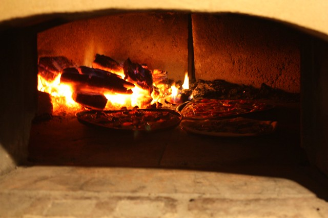 Making pizza in the pizza oven