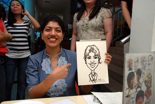 Caricature live sketching for BAT White Christmas Party 2010 - 22