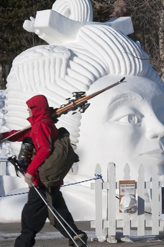 A skier walks by a snow sculpture in Breckenridge, Colorado. breckenridge event