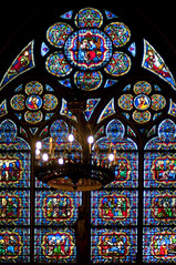 France - Paris - Notre Dame Stained Glass 03 (Darrell Godliman) Tags: travel light copyright paris france color colour building tourism church architecture nikon frankreich colorful europe catholic cathedral interior gothic eu stainedglass nave colourful vaulted francia notredamedeparis allrightsreserved notredamecathedral ledelacit architecturalphotography vaulting rpubliquefranaise travelphotography instantfave fourtharrondissement ourladyofparis omot 4tharrondissement travelphotographer flickrelite dgphotos darrellgodliman wwwdgphotoscouk architecturalphotographer d300s nikond300s dgphotosparis franceparisnotredamestainedglass03dsc4196