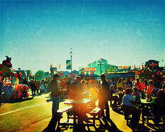The golden hour (Irene2005) Tags: sunset people food 35mm table october glow crowd sliding goldenhour lateafternoon longshadows ncstatefair f20 primelens nikond90 texturebyjessicadrossin gettycallforartists sliderssunday