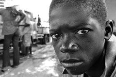 Denial of Childhood (magneticart) Tags: street portrait bw childhood haiti truth child adult grownups deny magneticart giovannisavino
