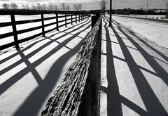 country fence (marianna a.) Tags: road blackandwhite bw fence countryside country perspective highcontrast monochromatic panasonic grayscale distance parallel fridays converging blackwhitephotos lumixg1 fencefridays mariannaarmata salonpolski
