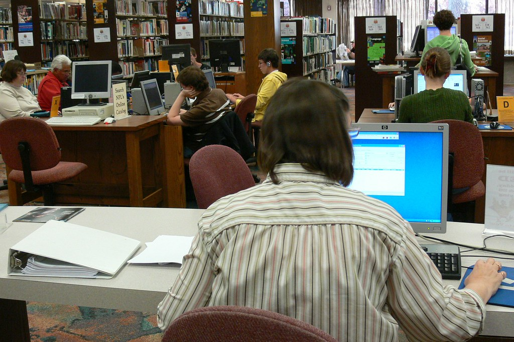 Staff look at records in the online catalog
