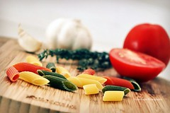 Life is a combination of magic and pasta. (Violet Kashi) Tags: wood food tomato italian dof bokeh sunday pasta garlic thyme penne cuttingboard tricolore hss