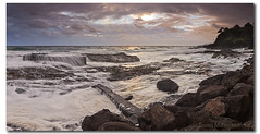 I dont have the magic to paint the sky blue when the dark clouds set in (danishpm) Tags: ocean panorama clouds sunrise canon rocks pano australia wideangle stormy qld aussie aus 1020mm manfrotto coolangatta sigmalens rainbowbay eos450d 450d sorenmartensen hitechgradfilters 09ndsoftgrad