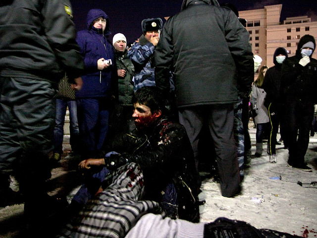 Russia -- Caucasian look men beaten up by fans on their action on Manezhnaya square in memory of Yegor Sviridov, killed by Caucasian jn december 6, 11Dec2010