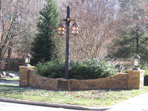 recent picture of finished center stone wall connecting two stone columns in Raleigh, North Carolina