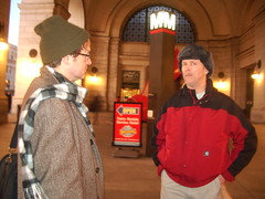 Thomas Nephew speaks to a passerby in a DC Metro station