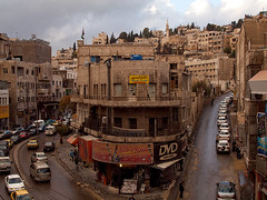 Downtown of Amman (Evgeni Zotov) Tags: road street city house building rain architecture way concrete asia downtown traffic amman middleeast jordan rainy crossroads jordania    jordani rdn