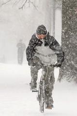 Snowy Ride (floralgal) Tags: winter snow newyork bicycle snowstorm snowfall blizzard candidportrait westchestercountynewyork portchesternewyork blizzardof2010 northeastwinterstorm manonbicycleinthesnow twomenwalkinginsnow