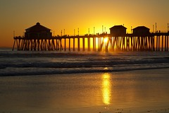 california (Eric 5D Mark III) Tags: california light sunset seascape color reflection beach silhouette canon landscape gold golden pier atmosphere orangecounty huntingtonbeach tone sunbursts ef24105mmf4lisusm eos5dmarkii