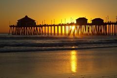 california (Eric 5D Mark III) Tags: california light sunset seascape color reflection beach silhouette canon landscape gold golden pier atmosphere orangecounty huntingtonbeach tone sunbursts ef24105mmf4lisusm eos5dmarkii