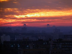 Red Sky in the Morning (Roblawol) Tags: nyc newyorkcity bridge sun plane sunrise buildings airplane morninglight apartments jet rays washingtonheights fortgeorge theheights 2011 whitestonebridge january4 010411