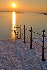 Walk to the sun (Shertila Tony) Tags: light sunset sea england sky fire golden europe britain railings marinelake wirral westkirby colorphotoaward platinumheartaward flickraward