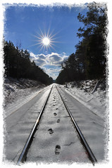 Broken Promises (Greg Foster Photography) Tags: railroad atlanta winter sky sun snow clouds georgia nikon tracks wideangle tokina f28 footprint sunflare uwa 2011 d90 1116mm atx116prodx