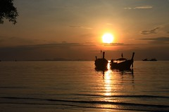 Railey Beach East (Tommy SO Lund) Tags: sea sky sun yellow sunrise thailand boats raileybeach