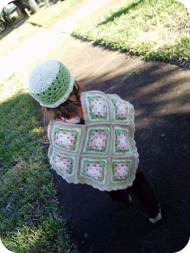 Junebug wearing toddler granny square poncho