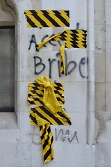 Strand (RCJ) 5oct16 (richardbw9) Tags: london uk england westminster strand royalcourtsofjustice graffiti tape tapedover maskingtape protest city street urban londonstreetphotography accept bribe yellowandblack gothicrevival building