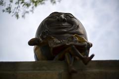 Humpty Dumpty Sat (Sean Anderson Media) Tags: humptydumpty shallowdof leicacsummicron40mmf2 sonya7rii leicalens leica primelens 40mm lensadapter leicamtosonyemount dlxstretchadapter waukeganpubliclibrary fotodiox dlxstretch leicam nurseryrhyme statue smile lookingdown fantasy fairytale lowangle