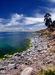 Isla Taquile Coastline, on Lake Titicaca (Eye of the Storym) Tags: lake tree beach peru laketiticaca titicaca water rock clouds landscape island coast horizon paisaje paisagem coastline serene altiplano puno waterscape lagotiticaca islataquile punoperu