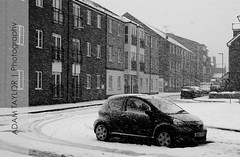 ~ Blizzard Conditions ~ (ADAM TAYLOR | Photography) Tags: road street uk winter shadow england blackandwhite white snow black streets cold building slr english cars ice car weather digital canon buildings season photography eos photo blackwhite photographer shadows seasons close place photos britain united great streetphotography photographers kingdom places location quay lincolnshire photographs photograph anchor lincoln gb roads dslr snowfall heavy tones tone winters locations blackandwhitephotography snows snowfalls wintry blackwhitephotography englishweather bizzard weathers blizzardconditions anchorquay 450d canoneos450d blizzardcondition