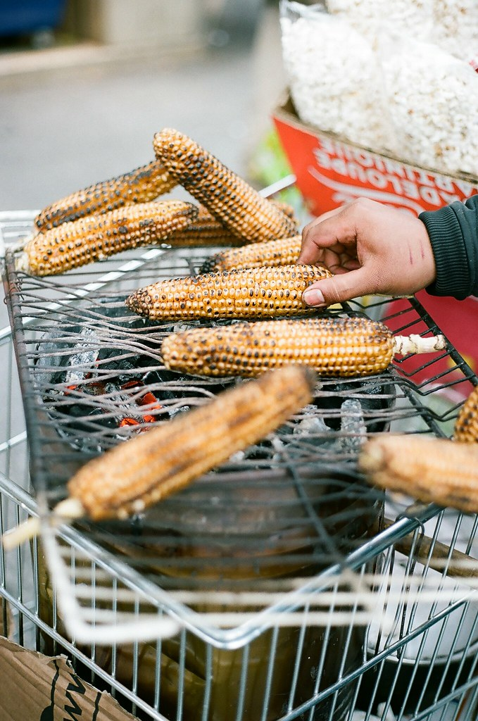 grilled street corn paris, france.