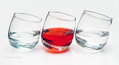 On the lean!! (Susan SRS) Tags: red stilllife glass glasses photo flickr waterglasses greatphotographers img9205 bestofblinkwinners tiltingglasses