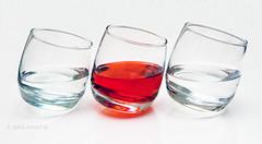 On the lean!! (Susan SRS) Tags: red stilllife glass glasses photo flickr waterglasses greatphotographers img9205 bestofblinkwinners tiltingglasses