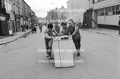 TOXTETH LOOTERS LOOTING URBAN UNREST RIOTS 1980S ENGLAND (Homer Sykes) Tags: uk england urban english britain july lancashire 80s 1981 british unrest 1980s riots workingclass gbr toxteth looting looters rioting britishsociety nearliverpool archivestock afternightriot