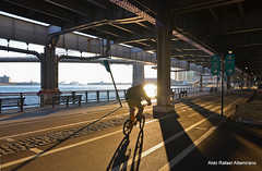 Ride (Rafakoy) Tags: park city nyc shadow sun ny newyork color colour water colors bike bicycle digital highway colours shadows manhattan under brooklynbridge manhattanbridge eastriver nikond7000 sigmaaf1750mmf28hsmdcexos