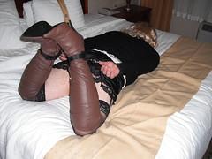 Holiday Inn Adventure (badger112957) Tags: brown black leather high boots bondage skirt jacket blonde hogtie heeled