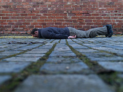 face-down on the cobbles