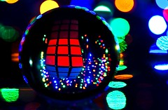 Squares in a ball.... ( Explore - Front Page ) (ryklin) Tags: light color reflection art colors lines ball reflections square nikon colorful dof artistic bokeh squares cube rubikcube d90 nikond90 ourdailychallenge nikon18200vrll