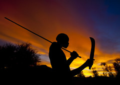 Sunset in Mucubal tribe - Angola (Eric Lafforgue) Tags: africa sunset shadow sky man tourism silhouette clouds soleil african culture tribal tribes blackpeople tradition tribe nuages ethnic cultura tribo headdress angola headwear 1927 ethnology headgear tribu tourismo herero etnia tnico etnias angolan ethnie hereros  mucubal   suldeangola mugubale      mucubai mucabale 154033761285881 southangola