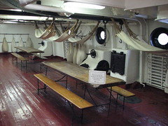 Hammocks and tables on the berth deck of the USS Olympia (FranMoff) Tags: boat ship navy hammocks tables olympia cruiser uss c6 ca15 protectedcruiser berths cl15 ix40