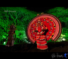 The unlikely duo-Padayani & Theyyam (Gulfu) Tags: india night canon candid kerala theyyam aluva tokina1224mm artforms padayani humangod 1000d nissinspeedlitedi622 prasanthchandran gulfuin gulfuphotography theunlikelyduopadayanitheyyam