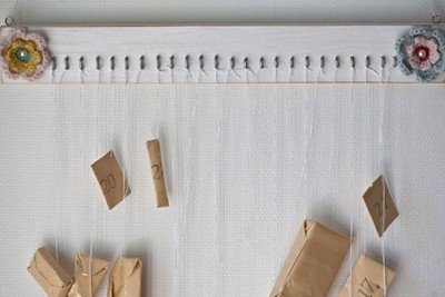 two flowers and some wood and hooks