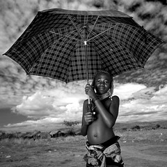 Mumuhuila girl with umbrella - Angola (Eric Lafforgue) Tags: africa sun hot tourism girl umbrella kid african culture tribal hasselblad heat tribes blackpeople tradition tribe ethnic cultura tribo huila angola ethnology tribu tourismo herero chaleur etnia tnico etnias angolan ethnie hereros 01776  mumuila h4d  muhuila  suldeangola mumuhuila mwila      s151439e133553 southangola
