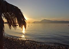 Sunset by the bridge (Nick in Greece) Tags: bridge sunset shadow sea sun reflection beach pinetree coast pebbles calm calmsea rioantirrio pentaxkxpine
