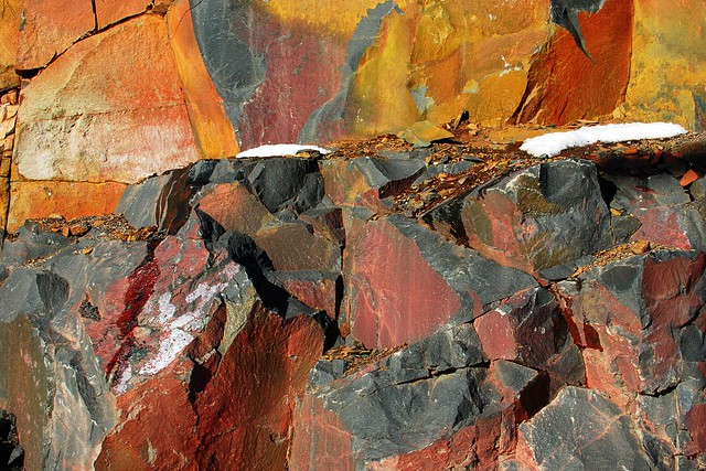 A brightly colored rock face.
