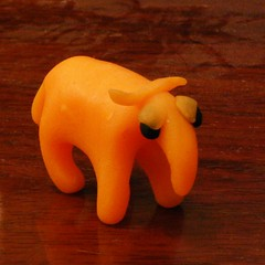 Orange skeptic (0olong) Tags: wood sculpture miniature critter piano polymerclay 0olong