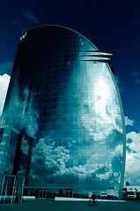crystallized clouds (hunter of moments) Tags: barcelona blue sky cloud azul hotel reflex nikon sailing w paisaje catalonia cielo espejo vela cristal nube d5000